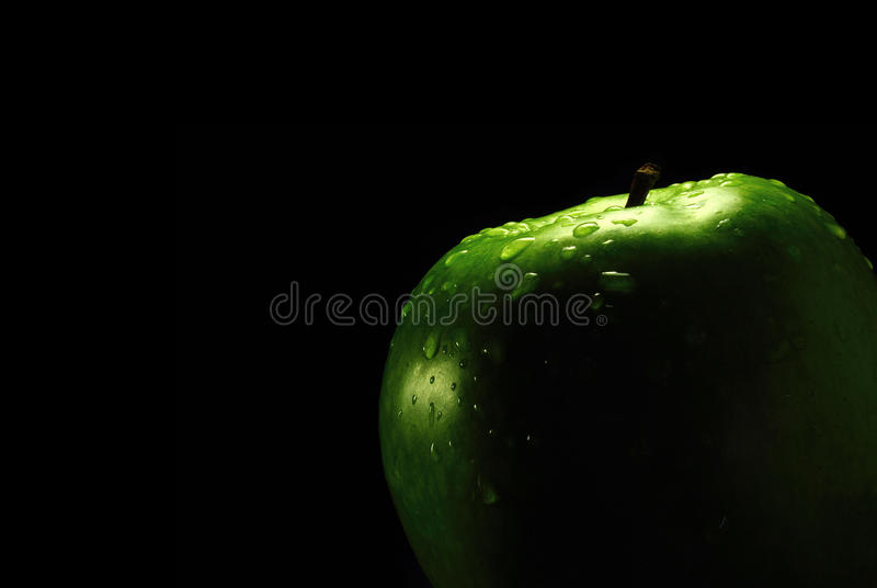 Apple and black royalty free stock photography