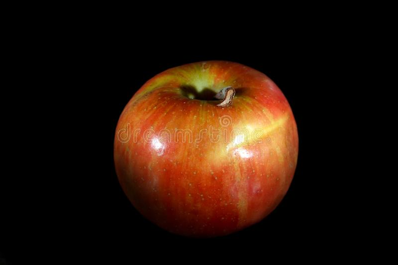 Apple on black background. Red apple on black background royalty free stock photography