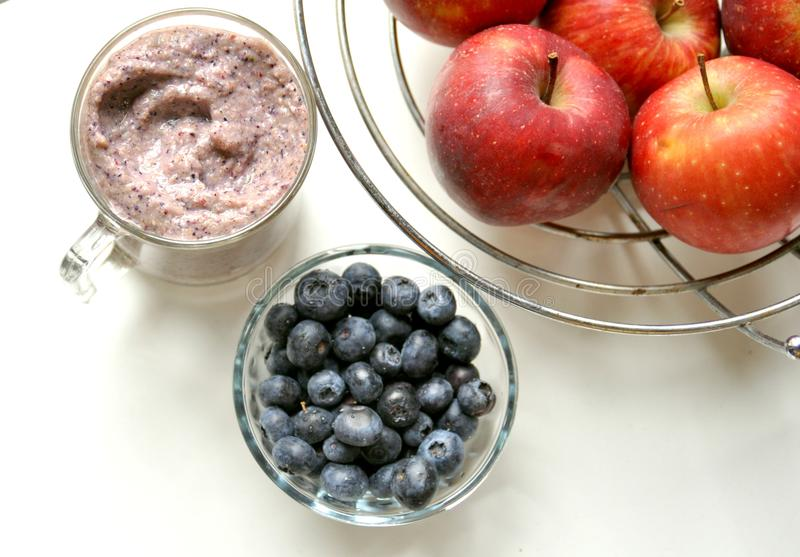 Apple and blueberry smoothie for breakfast royalty free stock photos