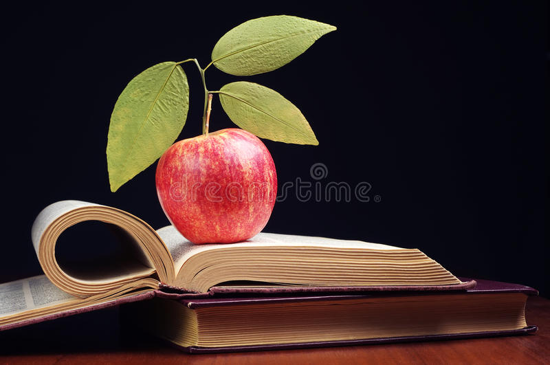 Download Apple and book stock photo. Image of table, literature - 35728556