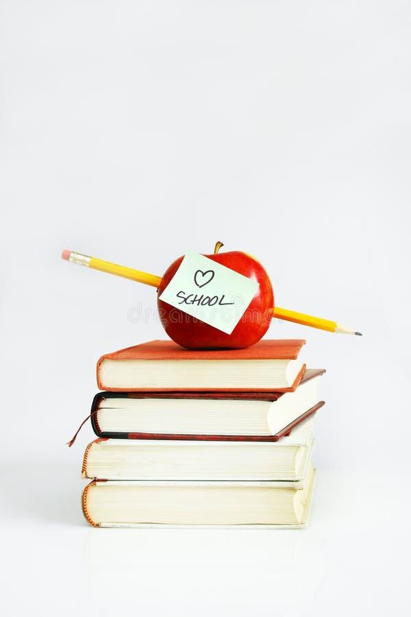 Apple on books royalty free stock photo