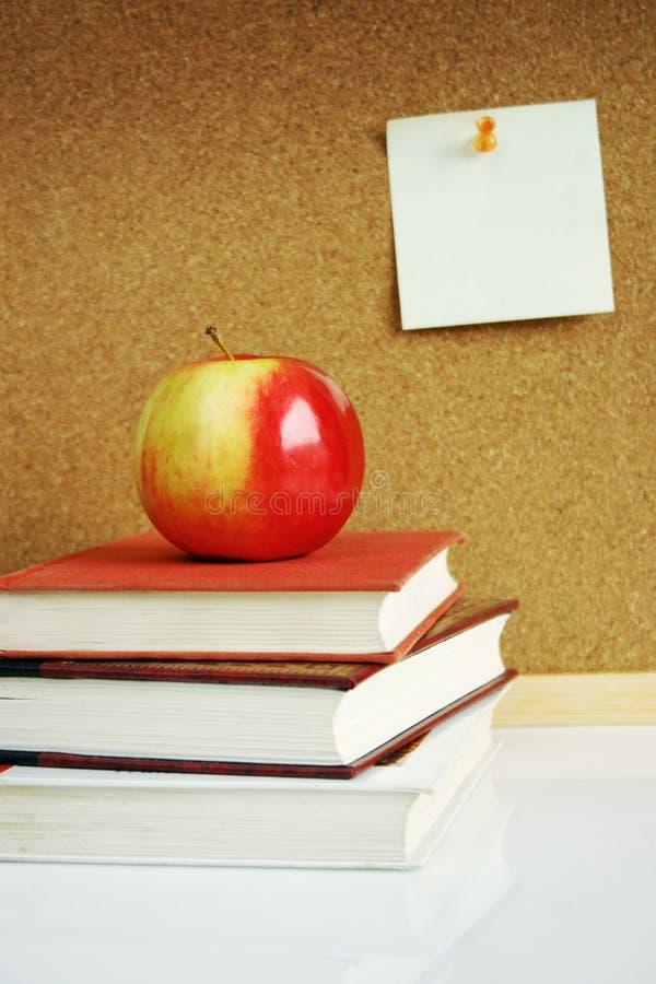 Apple on books stock image