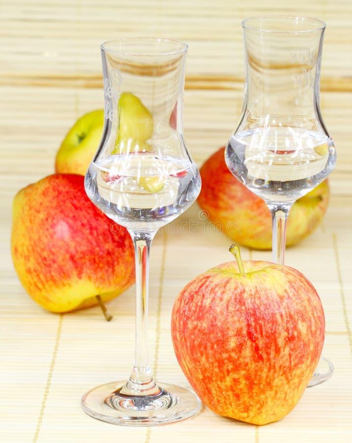 Apple brandy. And fresh apples stock photo