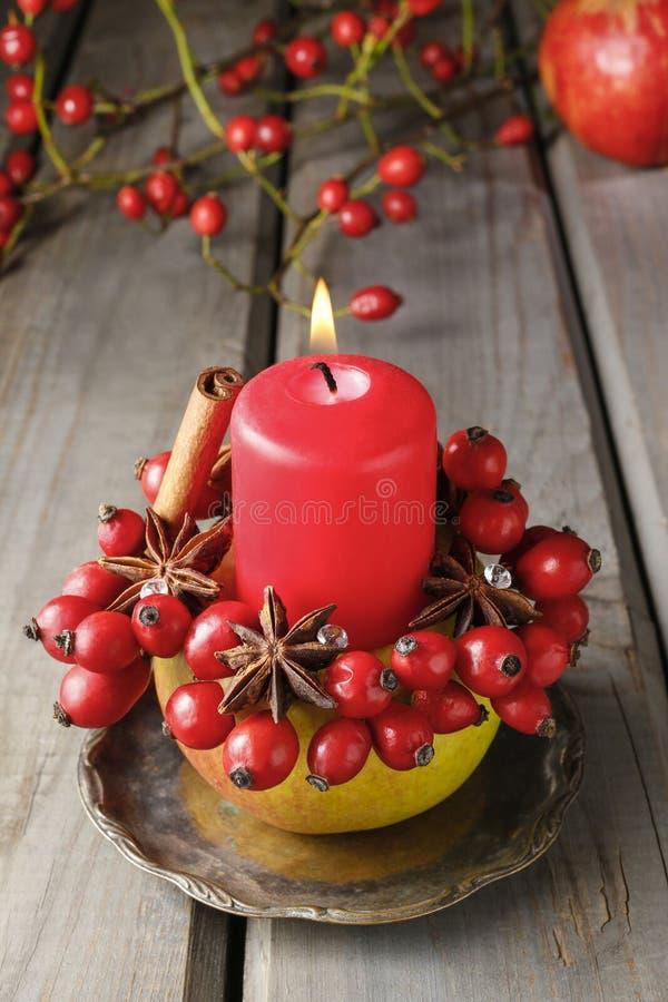 Apple candle holder - christmas home decor. Festive decoration royalty free stock photo