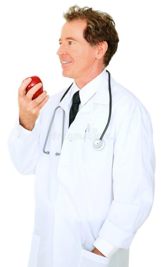 apple caucasian doctor eating isolated senior στοκ φωτογραφία