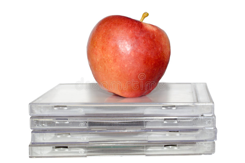 Apple on cds royalty free stock images