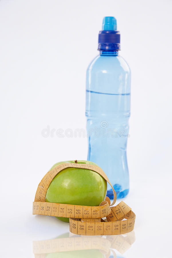Apple And Centimeters Royalty Free Stock Images