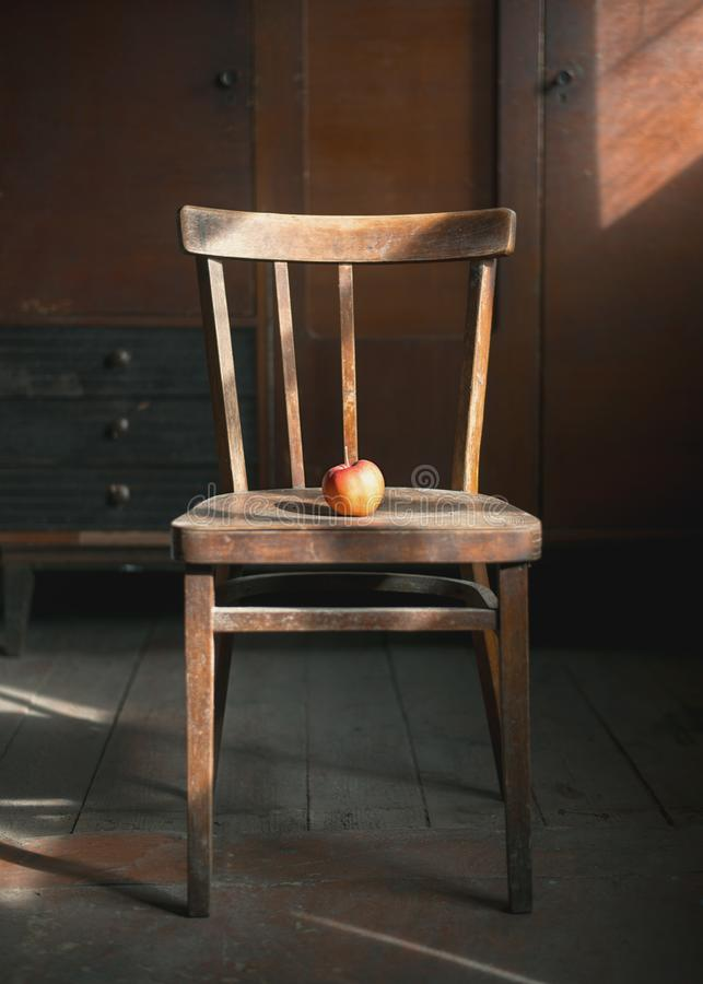 Apple on the chair royalty free stock image