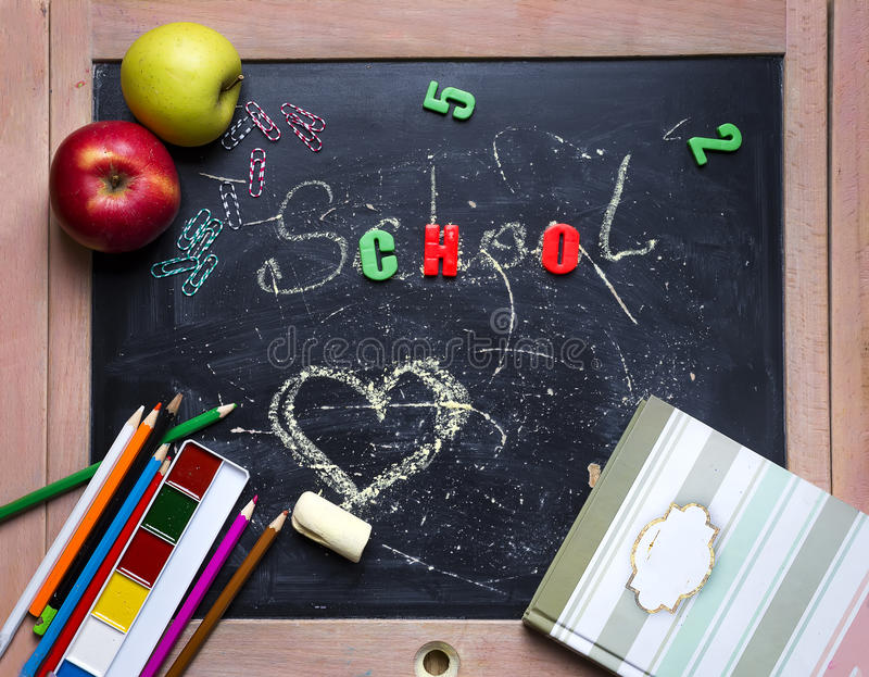 Apple and chalkboard. stock image