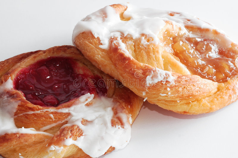 Apple and cherry danishes stock image