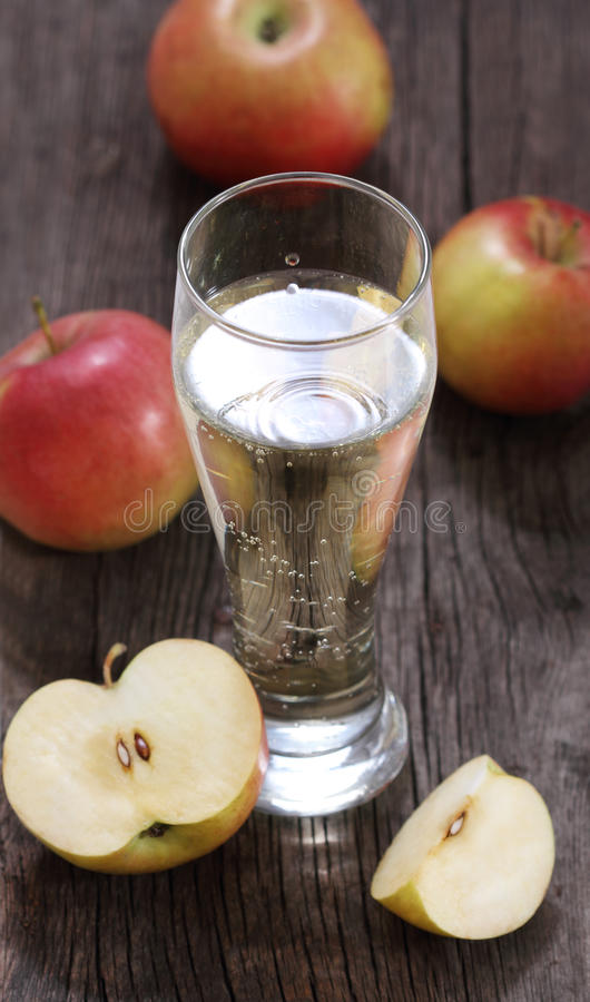 Apple cider. And apples on rustic wooden table stock images