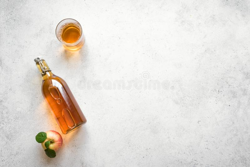 Apple cider drink. Or fermented fruit drink and organic apples on white, top view, copy space. Healthy eating and lifestyle concept stock photography