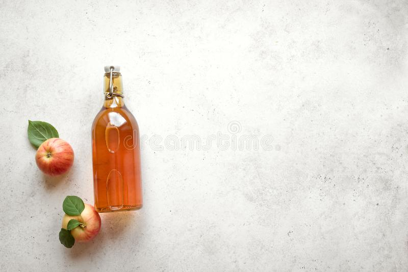 Apple cider drink. Or fermented fruit drink and organic apples on white, top view, copy space. Healthy eating and lifestyle concept royalty free stock image