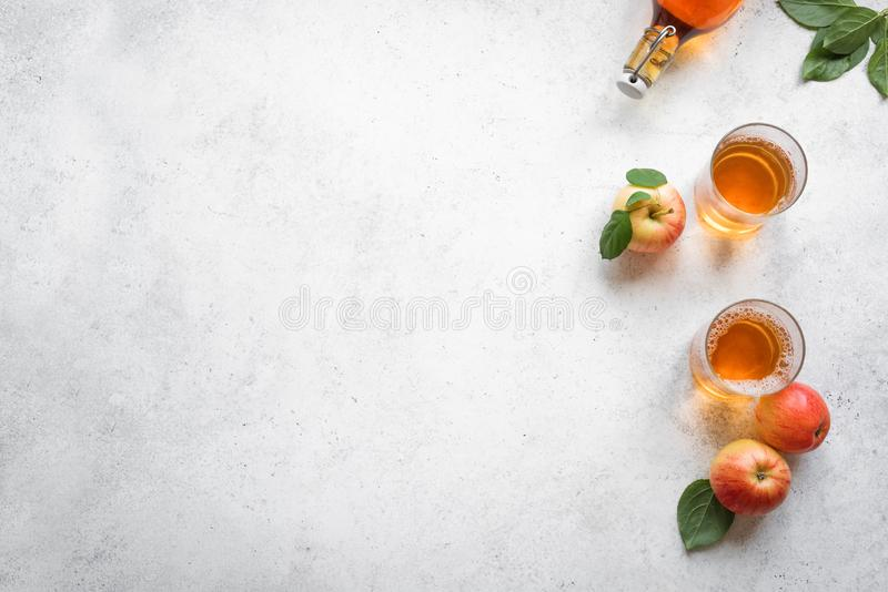 Apple cider drink. Or fermented fruit drink and organic apples on white, top view, copy space. Healthy eating and lifestyle concept stock photo