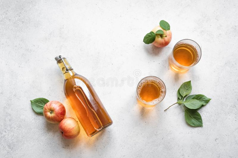 Apple cider drink. Or fermented fruit drink and organic apples on white, top view, copy space. Healthy eating and lifestyle concept royalty free stock photos