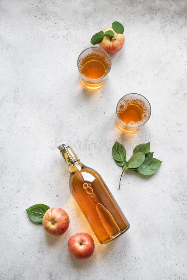 Apple cider drink. Or fermented fruit drink and organic apples on white, top view, copy space. Healthy eating and lifestyle concept royalty free stock images