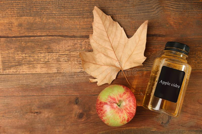 Apple cider in a jar. On a brown wooden background royalty free stock photography