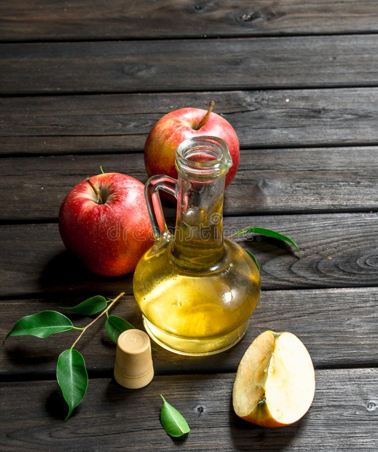 Apple cider vinegar with fresh apples stock images