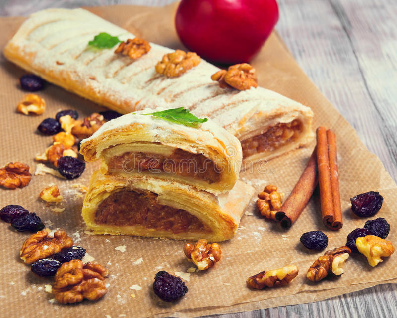 Apple cinnamon strudel with icing sugar stock images