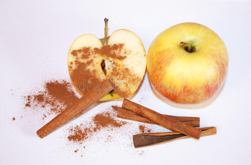 Apple with cinnamon. stock image
