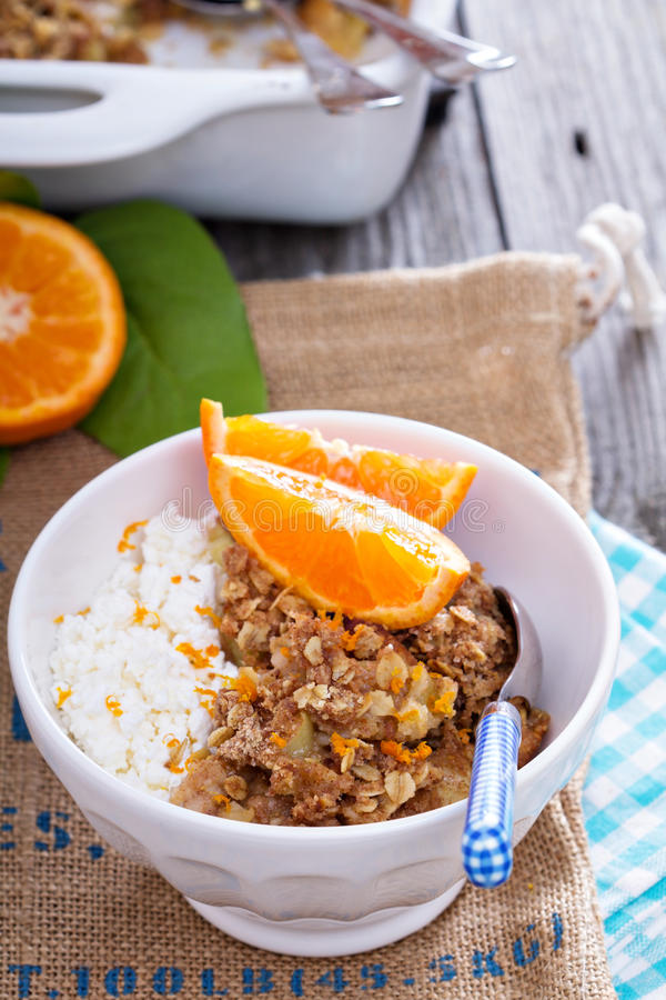 Apple and citrus crumble. With oats and orange zest royalty free stock images