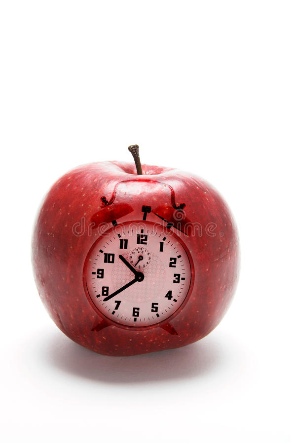 Apple and Clock. Composite of Apple and Clock on White Background royalty free stock photography