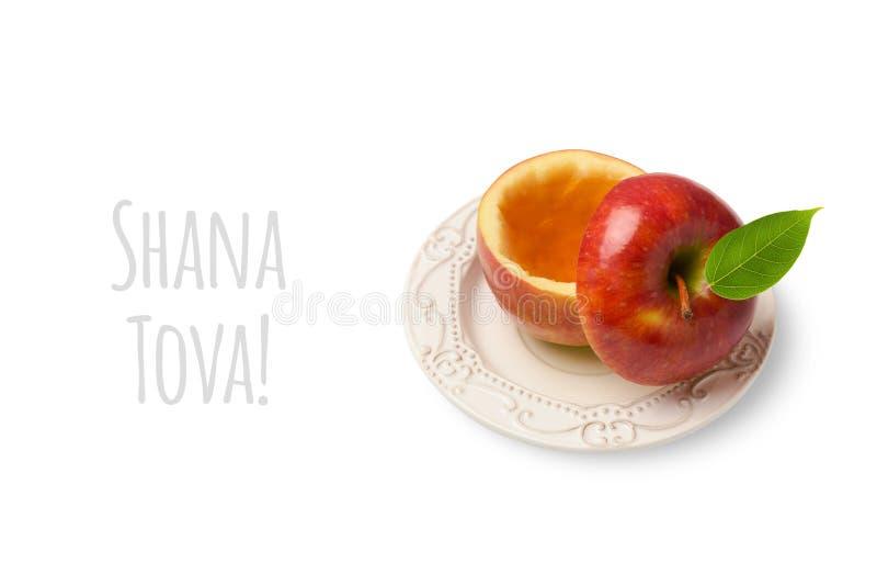 Apple com o mel isolado no fundo branco Conceito judaico de Rosh Hashanah do feriado do ano novo imagens de stock royalty free