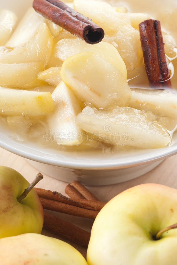 Apple Compote. Sweet and fresh apple compote with cinnamon royalty free stock photo