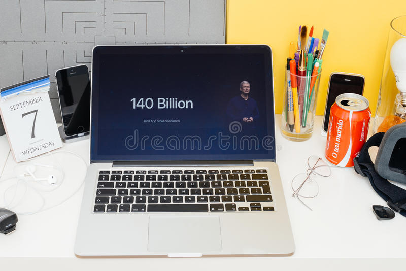 Apple Computers website showcasing 140 billion Apps downloaded. PARIS, FRANCE - SEP 8, 2016: Apple Computers website on MacBook Retina in room environment royalty free stock images