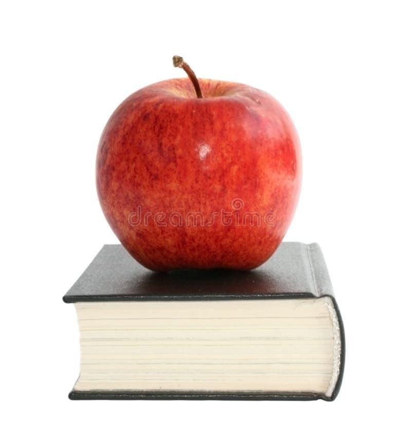 Apple con il libro immagine stock libera da diritti