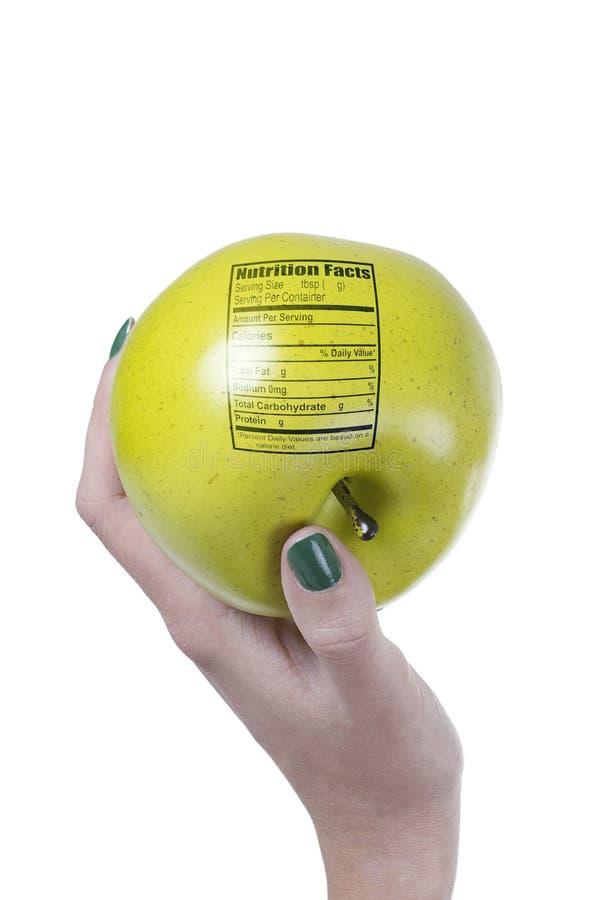Apple con l'etichetta di fatti di nutrizione immagini stock