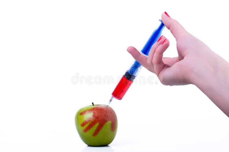 Apple con la siringa immagini stock