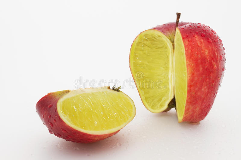 Download Apple containing a lemon stock image. Image of strange - 25552817