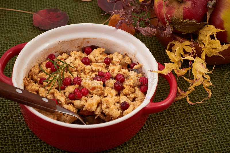 Apple crumble. With cranberry and rosemary royalty free stock photos