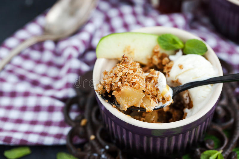 Apple crumble dessert with vanilla ice cream. Apple crumble crisp dessert with vanilla ice cream royalty free stock image