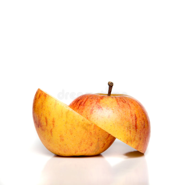 Apple cut. Red apple cut in two parts stock photography