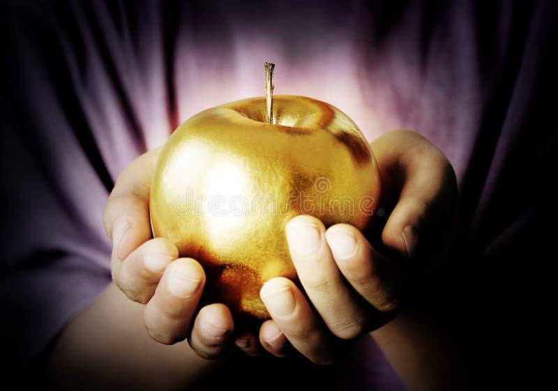 Apple d'or photo libre de droits