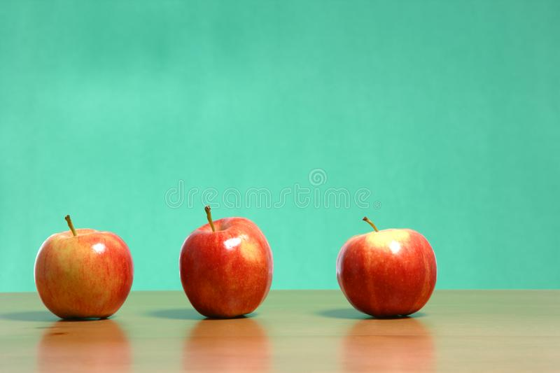 Apple on a desk stock photos