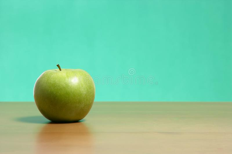 Apple on a desk stock photo