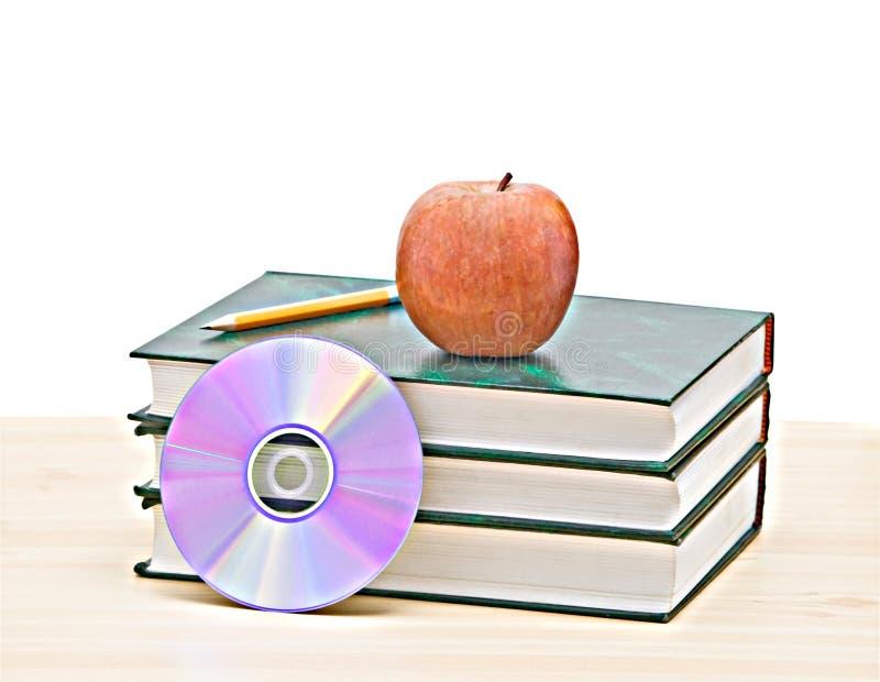 Apple, dvd e libri immagini stock