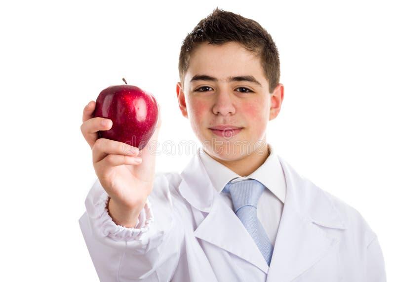 Apple dzień utrzymuje doktorskiego oddalonego, starego saying, obrazy royalty free