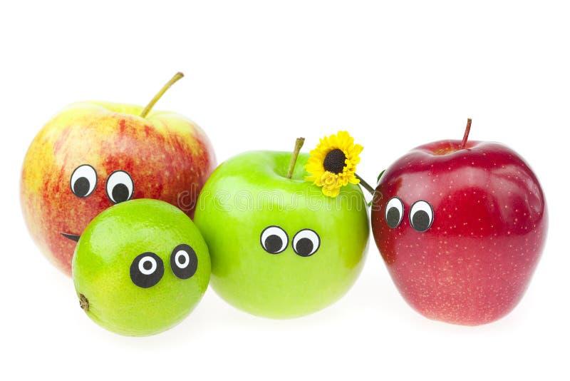 Apple e calce con gli occhi immagini stock