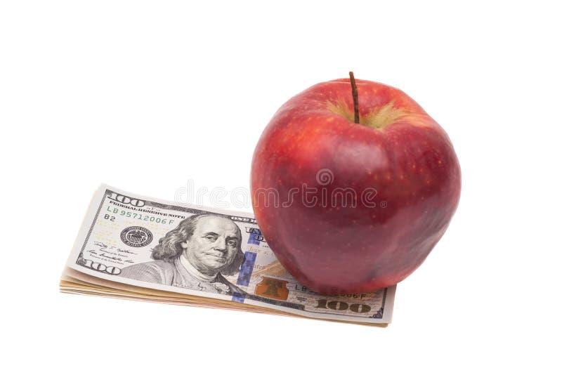 Apple e dólares foto de stock
