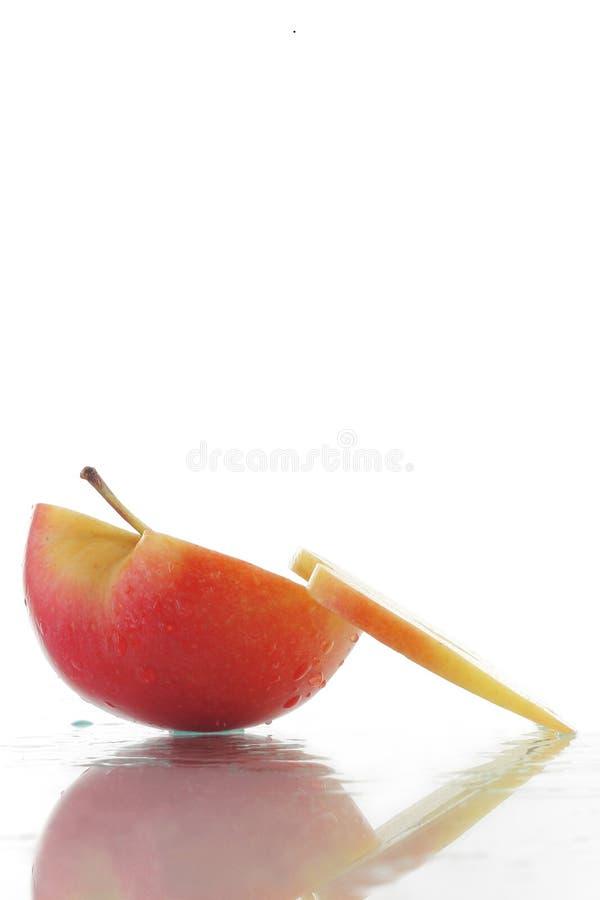 Apple e fatia 2 imagem de stock