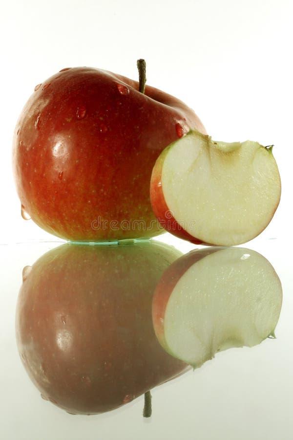 Apple e fatia imagem de stock