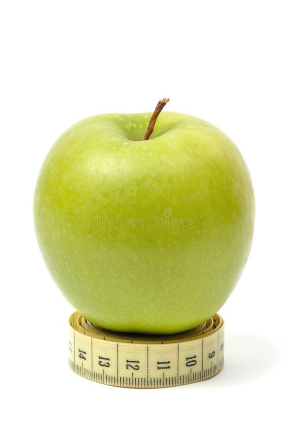Apple e fita de medição fotos de stock royalty free