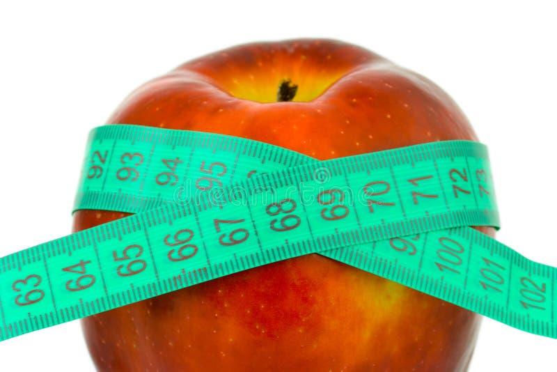 Apple e fita de medição foto de stock royalty free