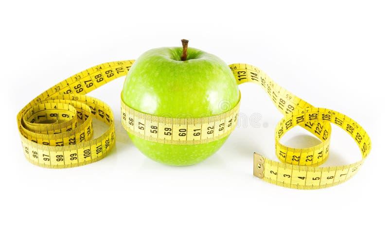 Apple e medidor imagens de stock