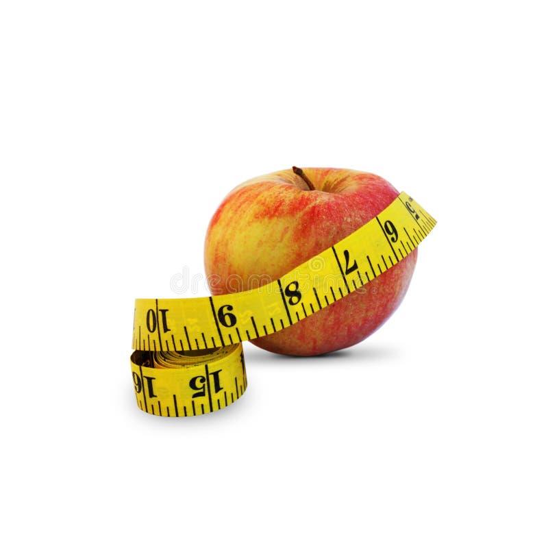 Apple e nastro di misura fotografie stock