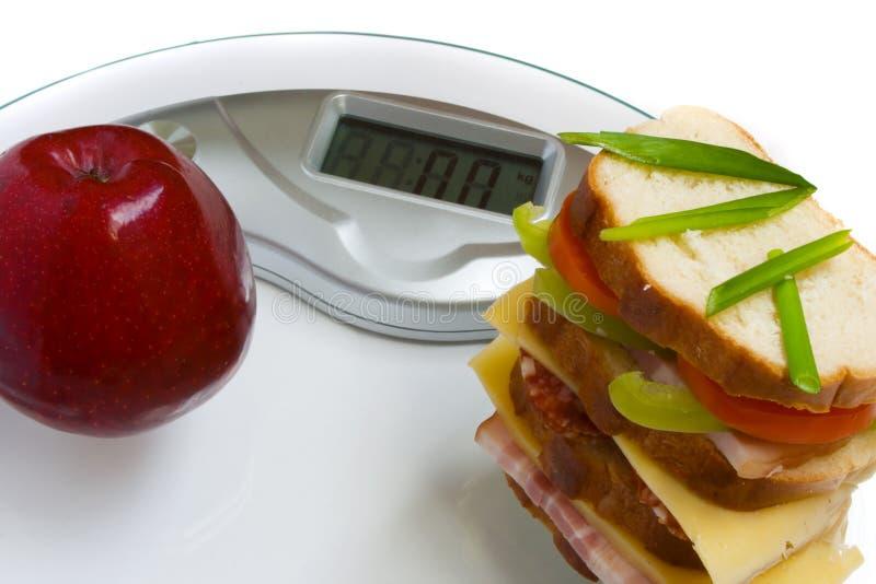 Apple e o sanduíche grande fotos de stock